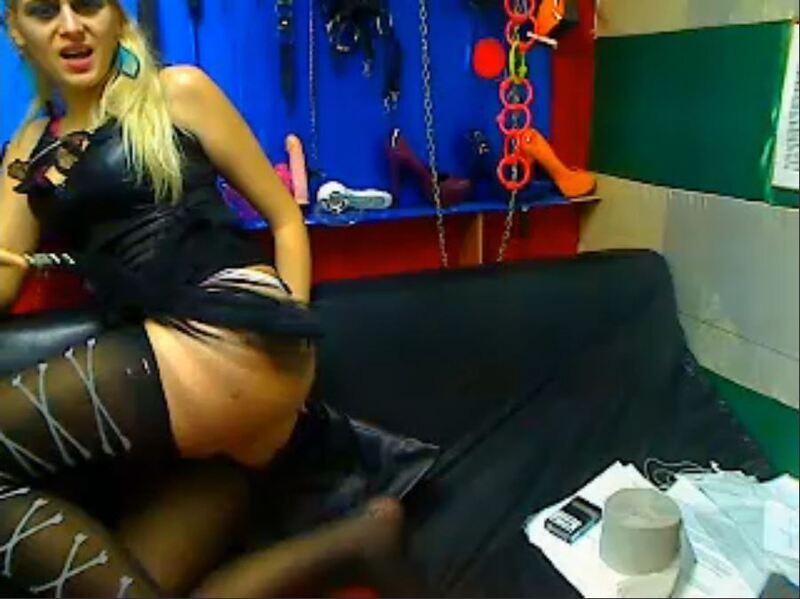 Screenshot of Kinky Blonde Fingering Her Ass