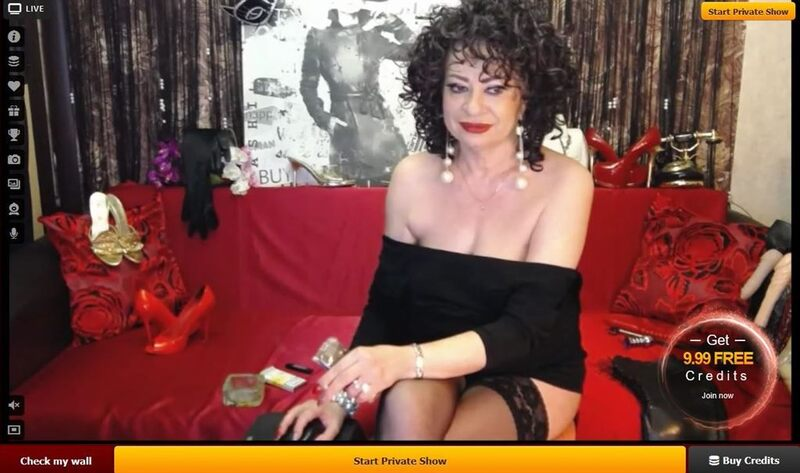 A sexy mature lady in a off-the-shoulder black shirt, shares a sexy smile on LiveJasmin.com